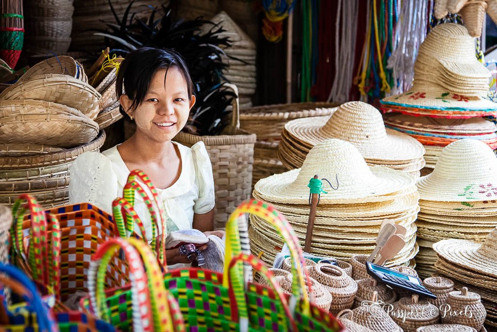 Hat and basket seller in a Myanmar market