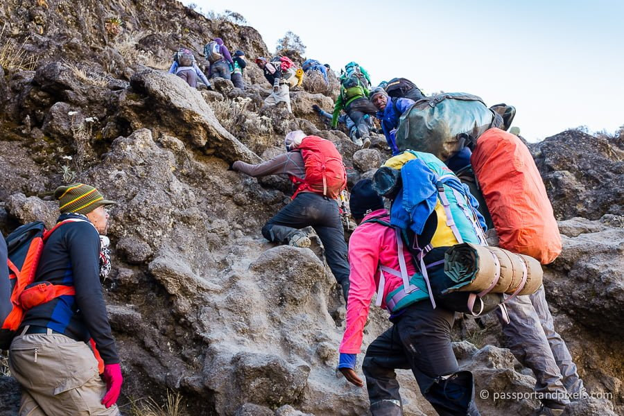 A close up of climbers going up the Barranco Wall on Mount Kilimanjaro