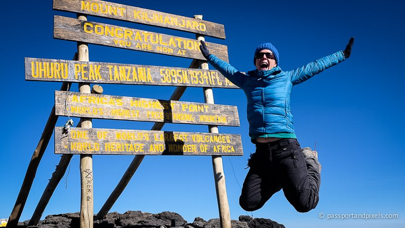 Jumping for joy at the Kilimanjaro Summit at Uhuru Peak