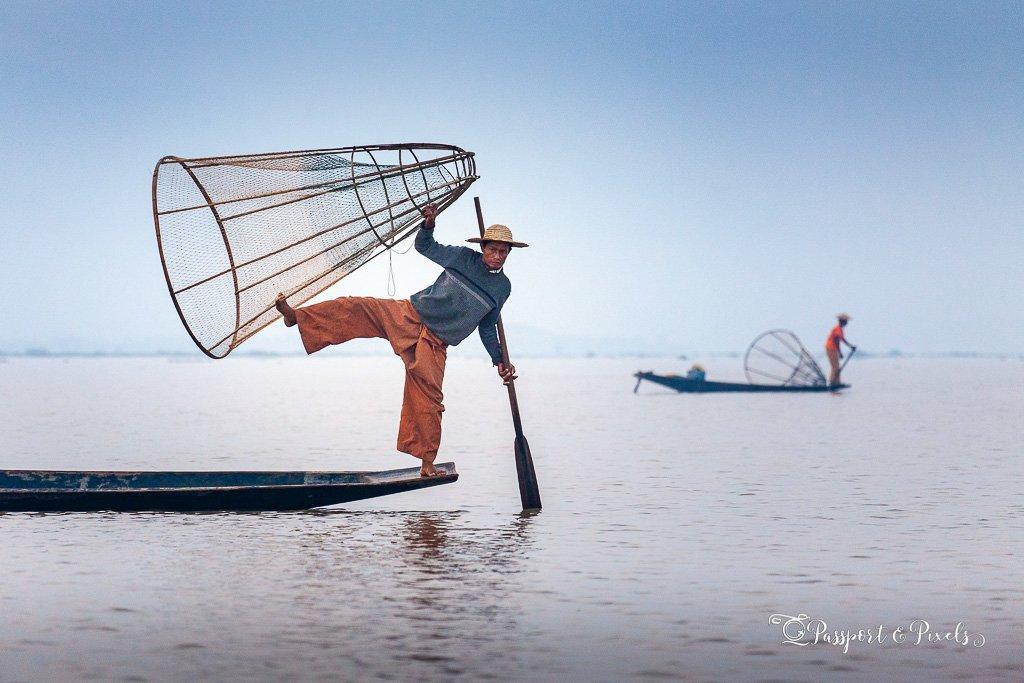 Leg-rowing fisherman balancing on his oar, Inle Lake, Myanmar