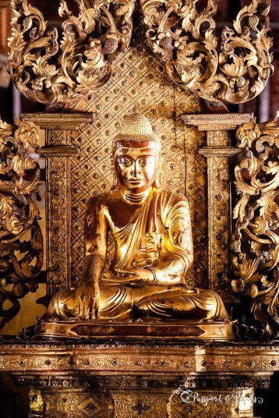 A gold buddha statue inside Shwe Inn Bin monastery, Mandalay