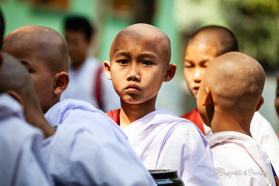 A novice monk queuing for lunch at Mahagandayon Monastery, Mandalay, Burma