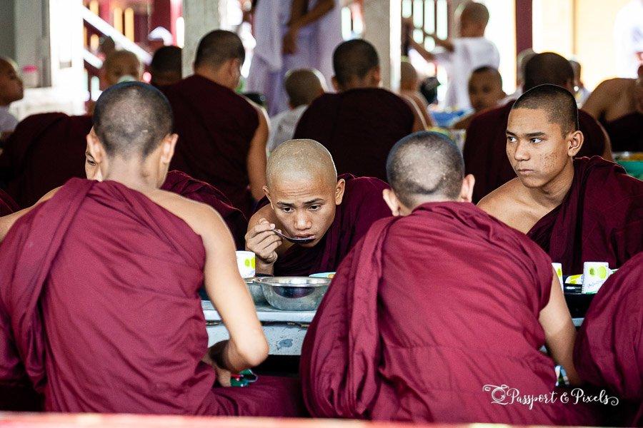 Buddhist monks eating lunch at Mahagandayon Monastery, Mandalay, Burma
