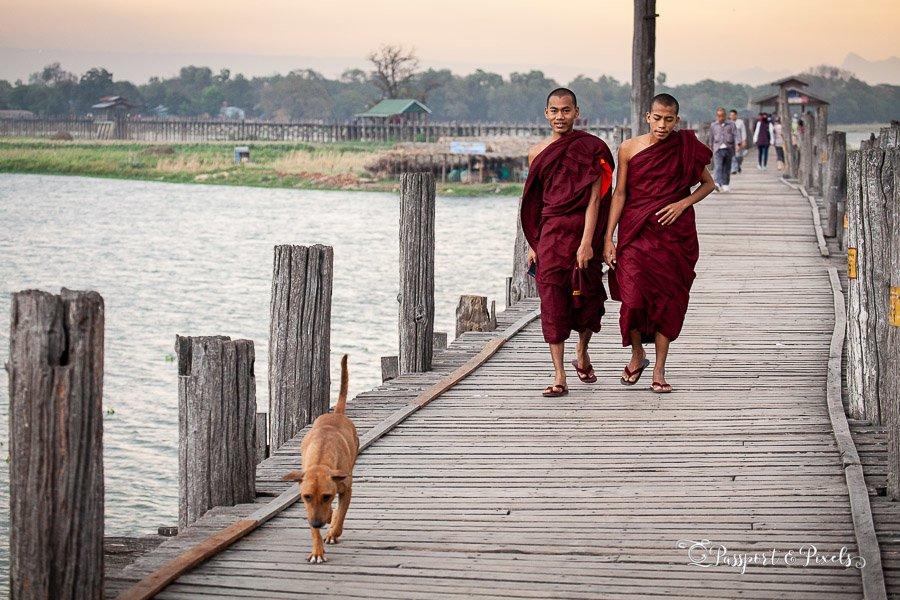 Buddhist monks crossing U Bein Bridge