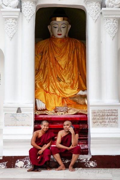 A photo of Buddhist monks resting at Shwedagon Pagoda, Yangon