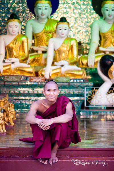 A photo of a Buddhist monk at Shwedagon Pagoda, Yangon