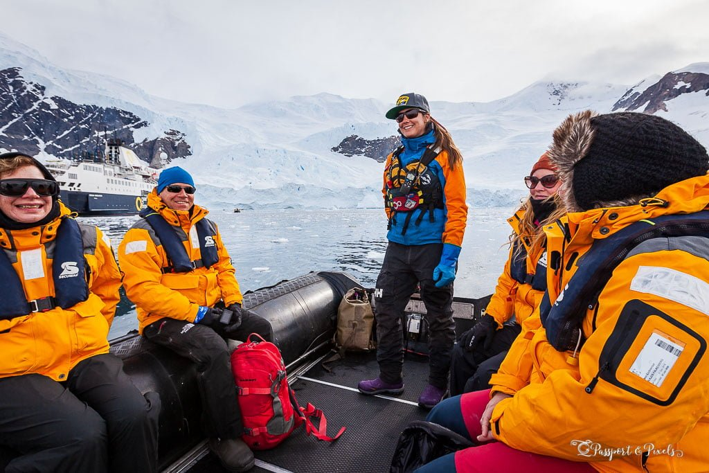 Tourists on a zodiac wearing expedition jackets in Antarctica