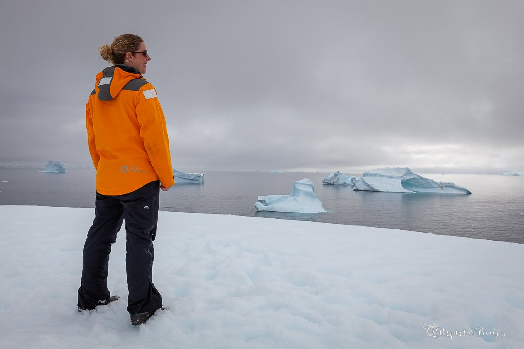 Wearing a yellow expedition parka in Antarctica