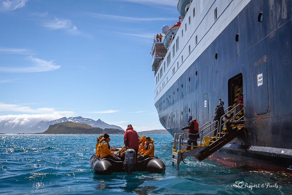 Boarding a zodiac from the cruise ship