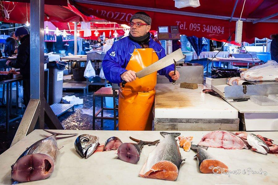 Fishmonger at the Catania fish market, Catania, Sicily