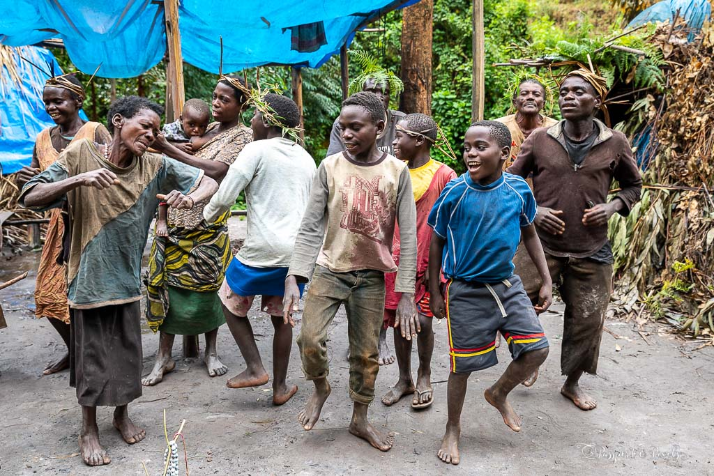 Batwa people perform traditional dances for visitors