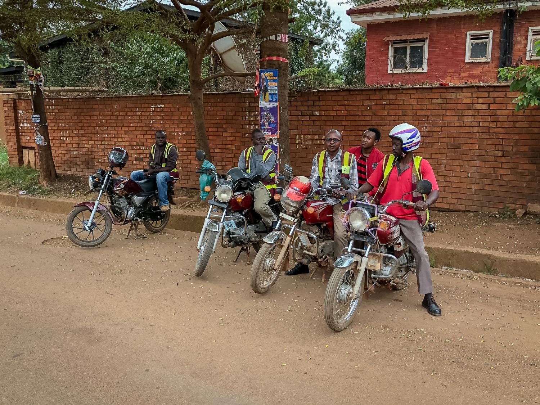 Boda boda drivers wait for passengers in Kampala, Uganda