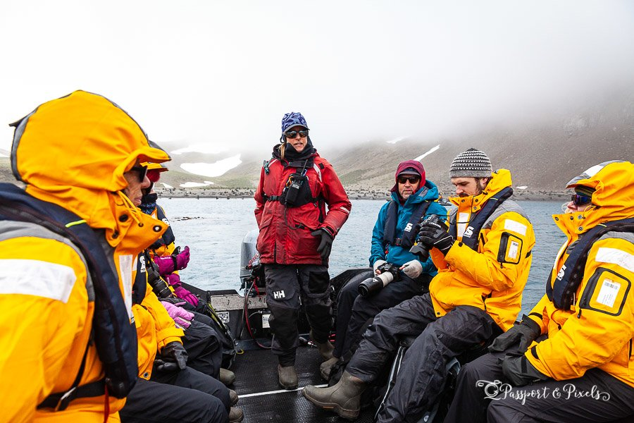Tourists on a zodiac wearing warm Antarctic clothes