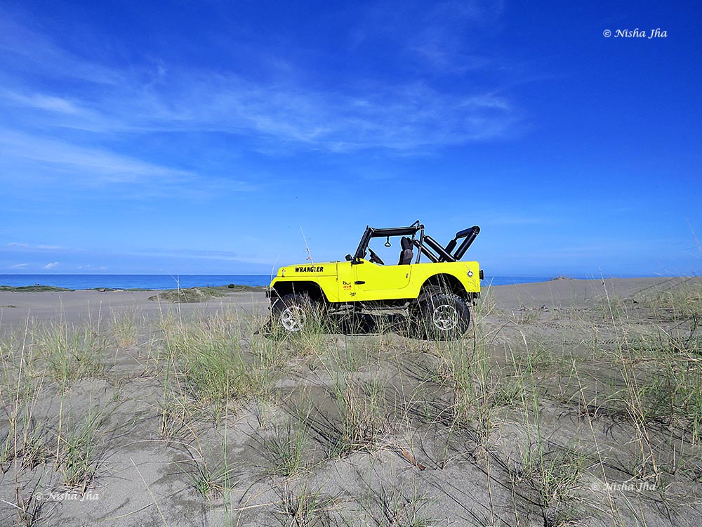 Yellow car against a blue sky. Taken on the Canon Powershot SX60